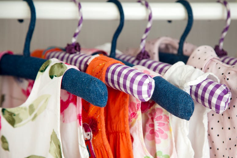 Girl's clothes hanging in closet