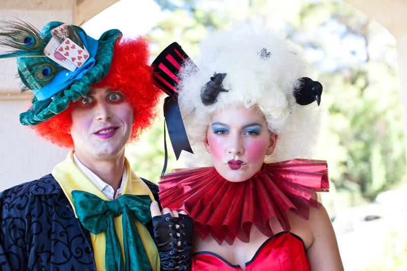 Man dressed as Mad Hatter and woman as Queen of Hearts from Alice in Wonderland