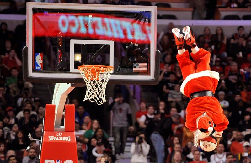 santa shooting a big hoop on the basketball court on christmas