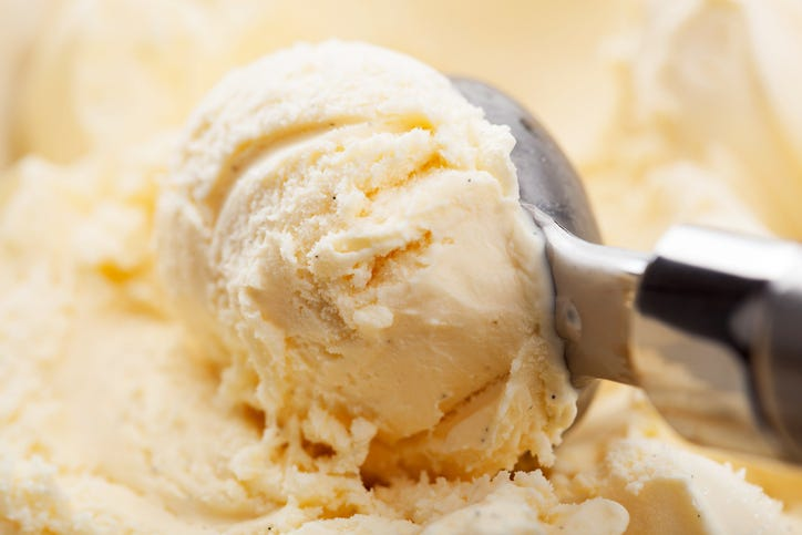 Vanilla ice cream being scooped up.