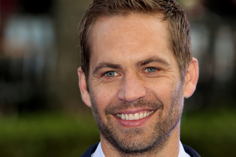 paul walker smiling on red carpet