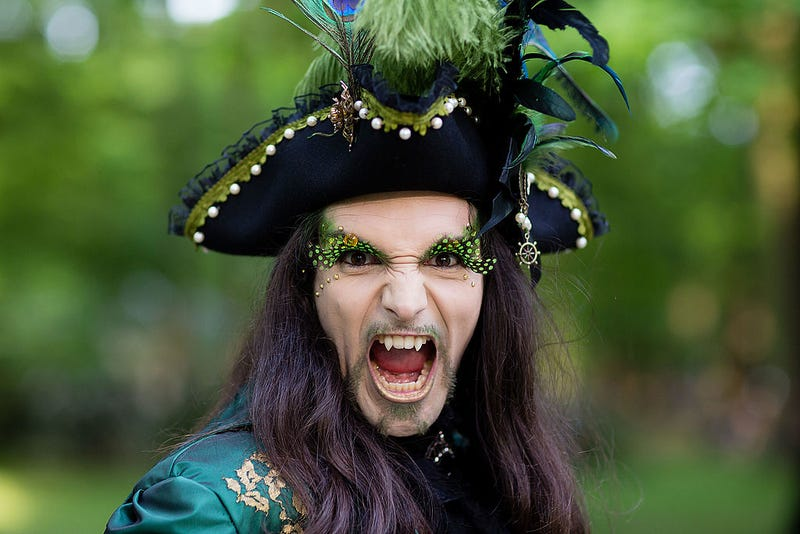 A man with fake vampire teeth wearing a costume attends the traditional park picnic on the first day of the annual Wave-Gotik Treffen, or Wave and Goth Festival, on May 17, 2013 in Leipzig, Germany.