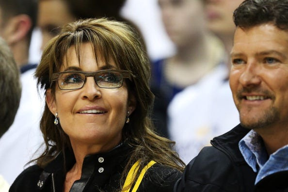Sarah Palin and husband Todd catch a basketball game.
