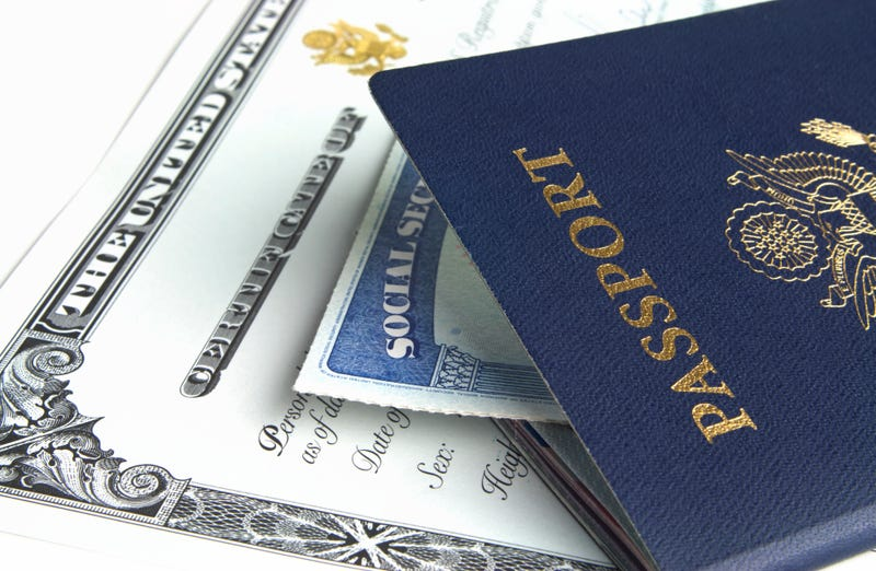 Blue American passport with citizenship documents on white background.