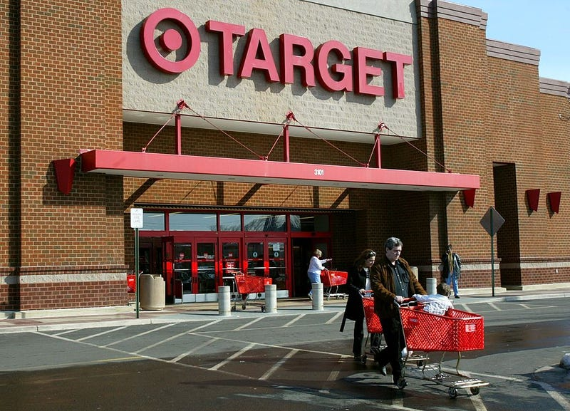 Shoppers leave a Target store