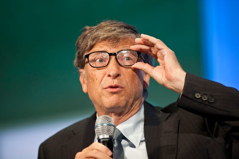 bill gates adjusts glasses on stage