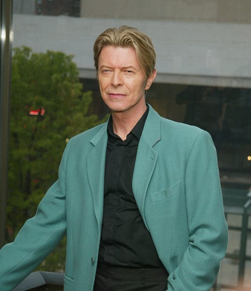 Singer David Bowie stands backstage at The Film Society of Lincoln Center's Tribute to Susan Sarandon at Avery Fisher Hall May 5, 2003 in New York City.