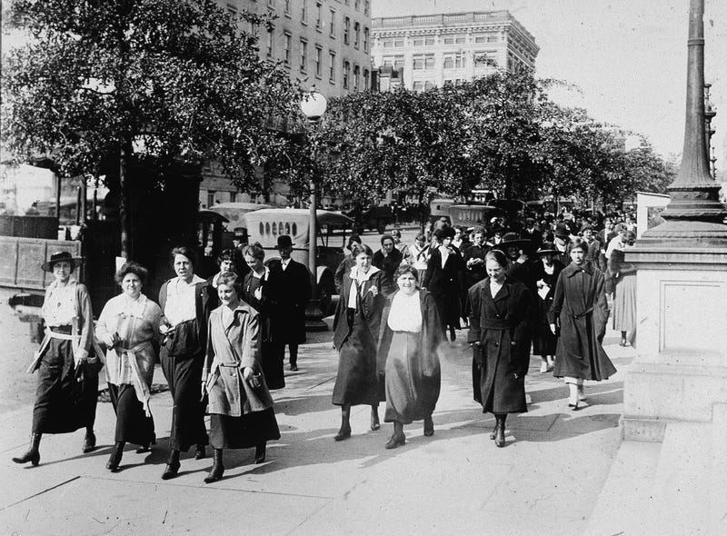 A group of women walking on city streets circa 1919