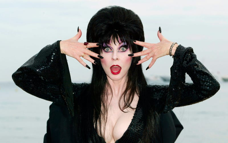 """Actress Cassandra Peterson """"Elvira"""" poses during a photo call for the film """"Elvira's Haunted Hills"""" at the Rado Beach"""