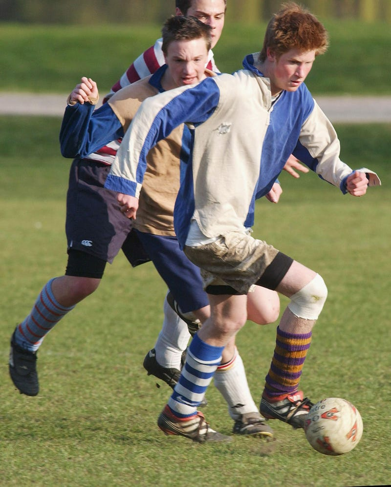 prince harry plays soccer during his last year of attendance at eton college