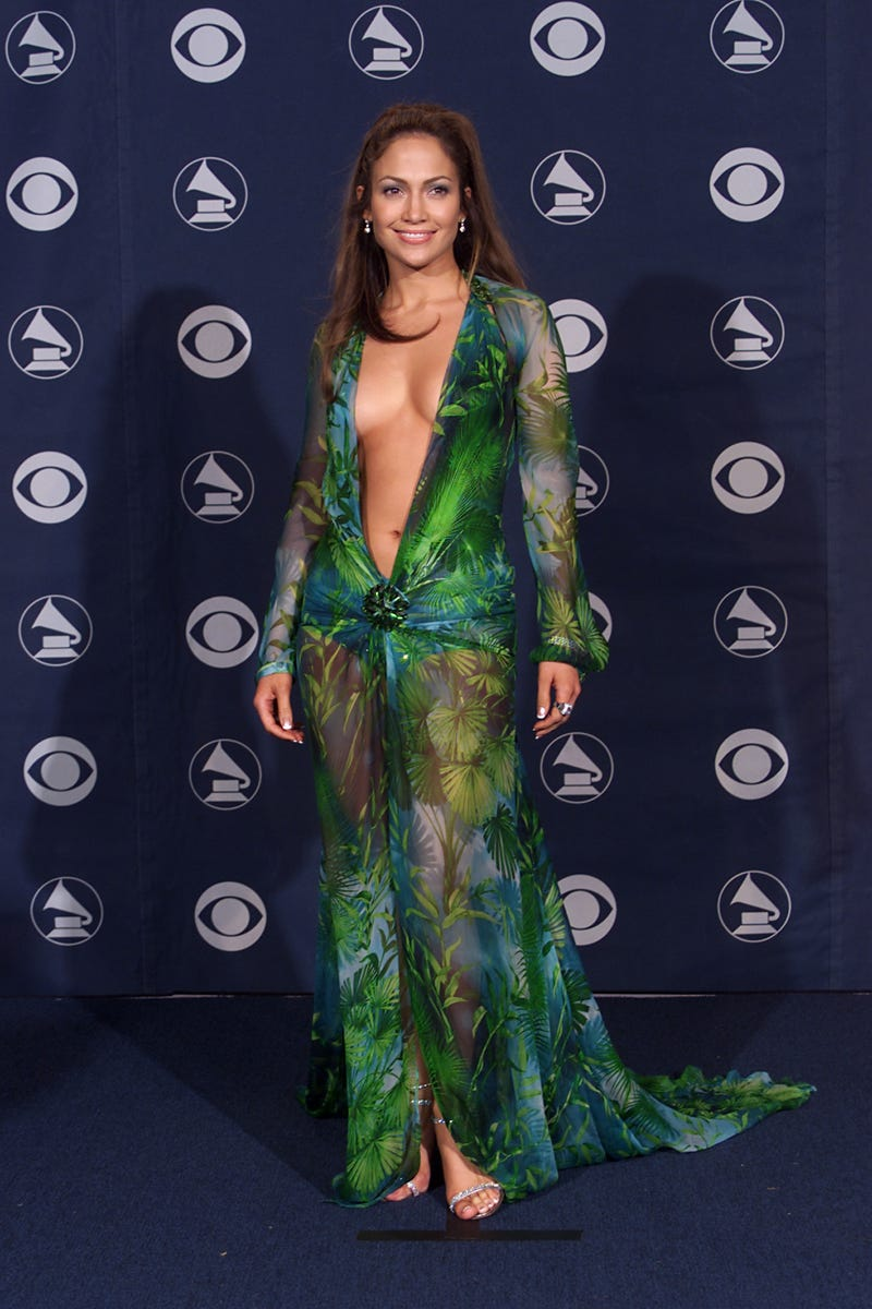 jennifer lopez smiles in her controversial green versace gown at the 2000 grammy awards