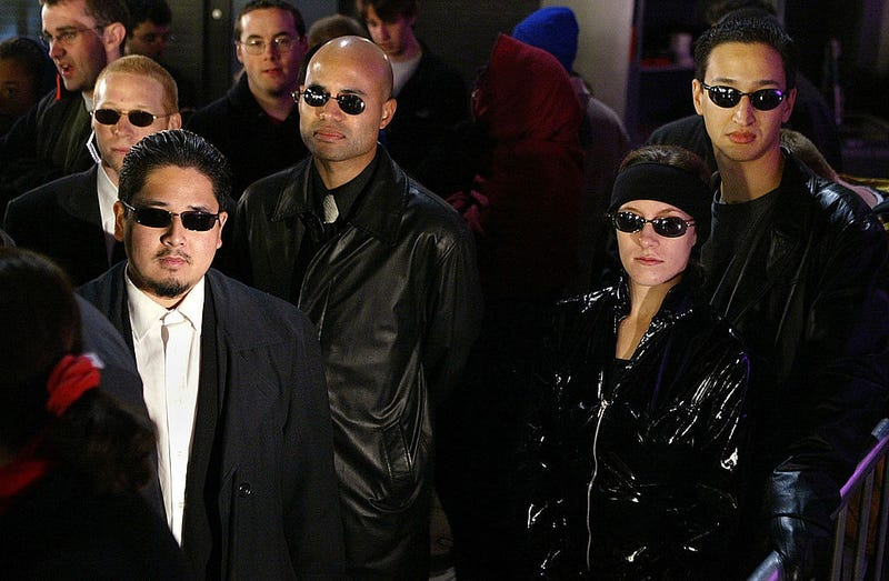 Fans dressed as characters from the movie line up for the opening of the film Matrix Revolution at Graumann's Chinese Theater November 5, 2003 in Hollywood, California.