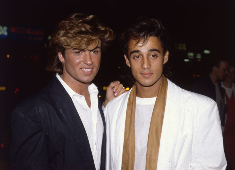 British singer songwriter George Michael, lead singer of the pop group Wham!, with the group's guitarist Andrew Ridgeley at the film premiere of the hit 'Dune'.