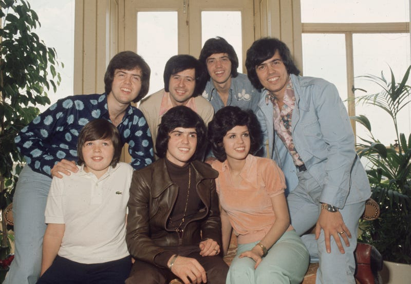 circa 1975: The Osmonds, known as the first family of pop. In the front row are (left to right) Jimmy, Donny and Marie Osmond. Behind them are brothers Alan, Wayne, Merrill and Jay. (Photo by Hulton Archive/Getty Images)