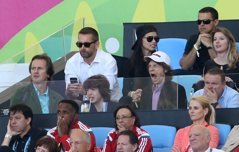mick jagger yawns at soccer game with his son