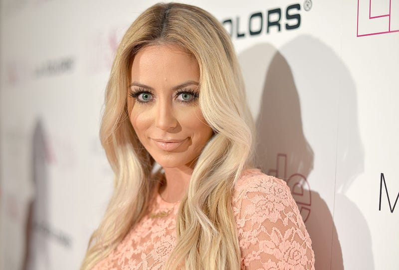 Aubrey O'Day Accuses Flight Attendant of Forcing Her to Take Her Shirt Off