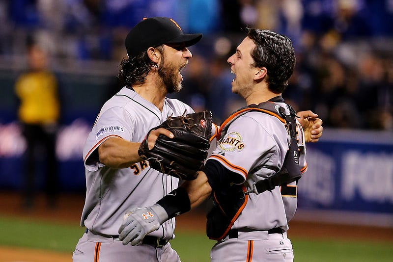 Madison Bumgarner and Buster Posey celebrate during the 2014 World Series