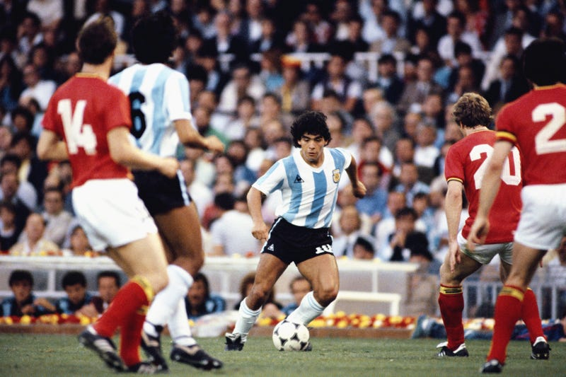 Argentina player Diego Maradona (c) takes on the Belguim defence during the 1982 FIFA World Cup match between Argentina and Belguim at the Nou Camp stadium on June 13, 1982 in Barcelona, Spain.