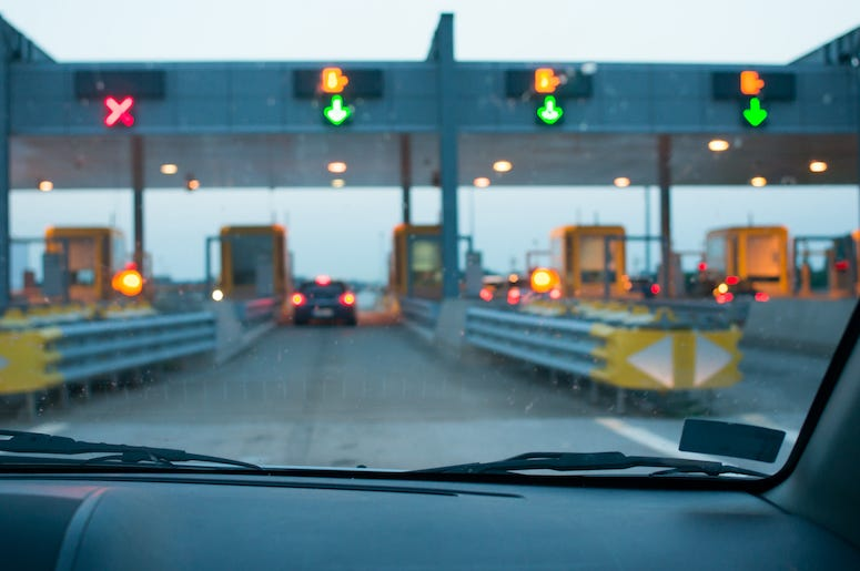 Driving into toll booth