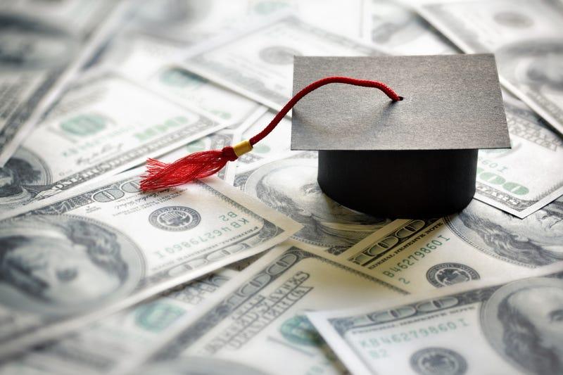 graduation cap on US hundred dollar bills