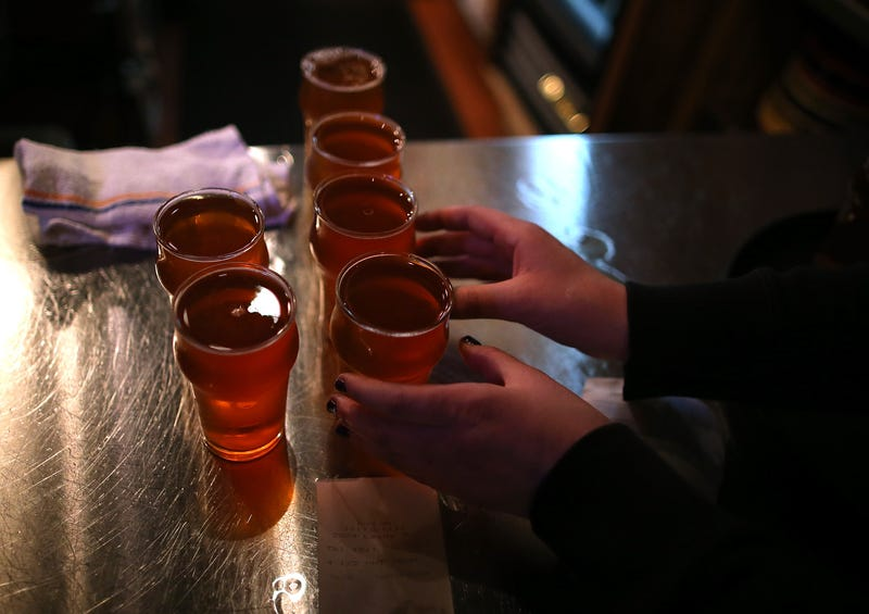 A Russian River Brewing Company server picks up glasses of the newly released Pliny the Younger triple IPA beer on February 7, 2014 in Santa Rosa, California.