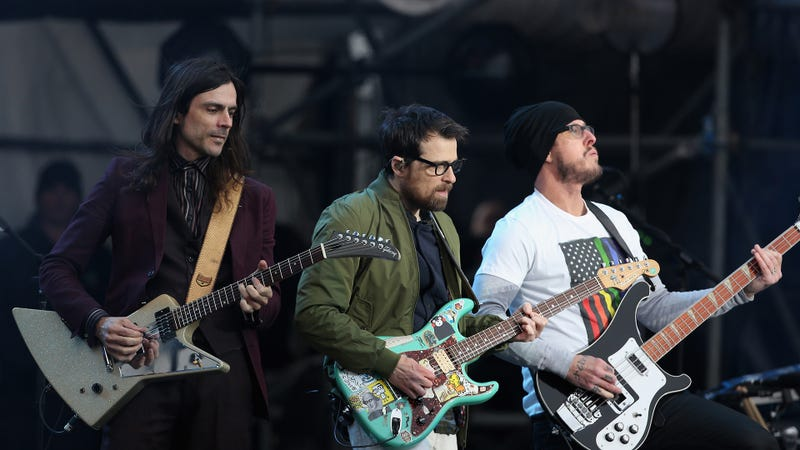 Brian Bell, Rivers Cuomo, and Scott Shriner of Weezer