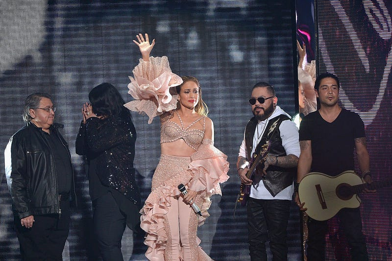 Jennifer Lopez and Los Dinos onstage after performing musical tribute to Selena at the 2015 Billboard Latin Music Awards presented bu State Farm on Telemundo at Bank United Center on April 30, 2015 in Miami, Florida.