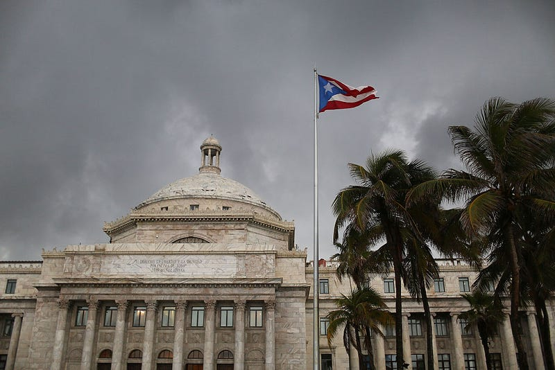 The Puerto Rican flag flies near the Capitol building