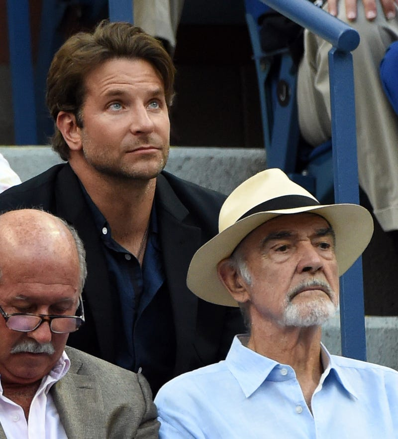 Bradley Cooper (L) and Sean Connery watch Novak Djokovic of Serbia play against Marin Cilic of Croatia during their 2015 US Open Men's Singles -Semifinals at the USTA Billie Jean King National Tennis Center September 11, 2015 in New York.