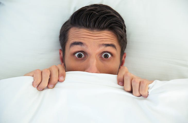 Man under the covers