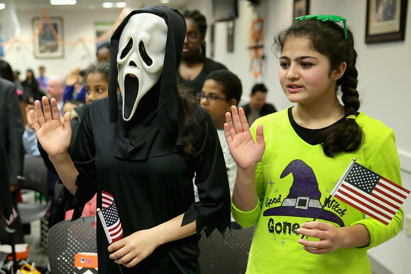 Dressed as the title character from the movie Scream, Javaria Khattak (L), 14, her sister Mishal Khattak, 12, and 26 other children wear Halloween costumes.
