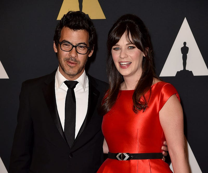 Zooey Deschanel and Jacob Pechenik attend a red carpet event.