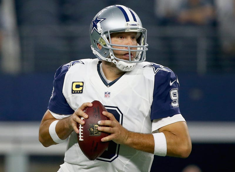 Tony Romo looks downfield for an open receiver