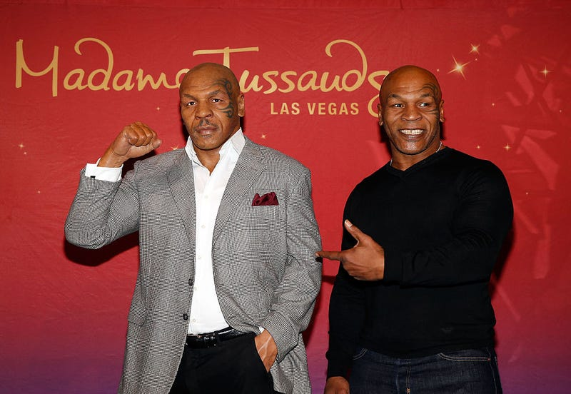 Boxing legend and entertainer Mike Tyson unveils his first Madame Tussauds wax figure at Venetian Las Vegas in 2015.