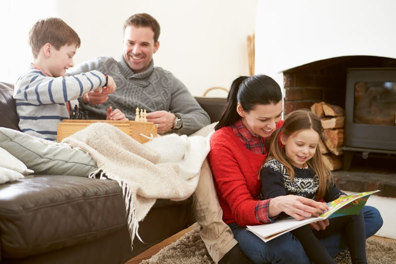 Adults and kids play games and read together