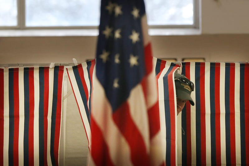 A man exits a voting booth inside of a middle school serving as a voting station on the day of the New Hampshire Primary on February 9, 2016 in Bow, New Hampshire.
