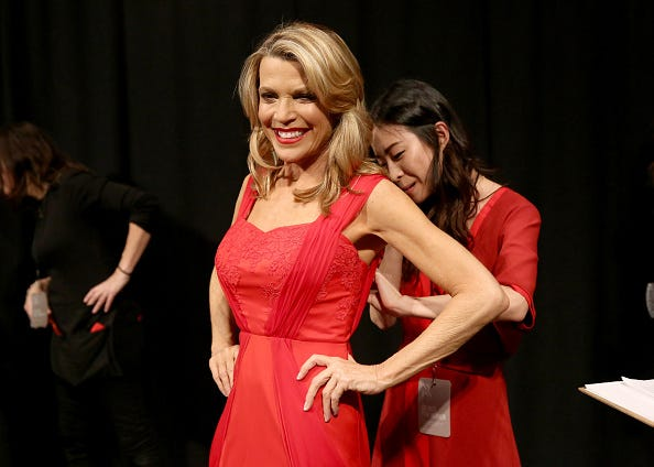 Vanna White is fitted into an evening gown.