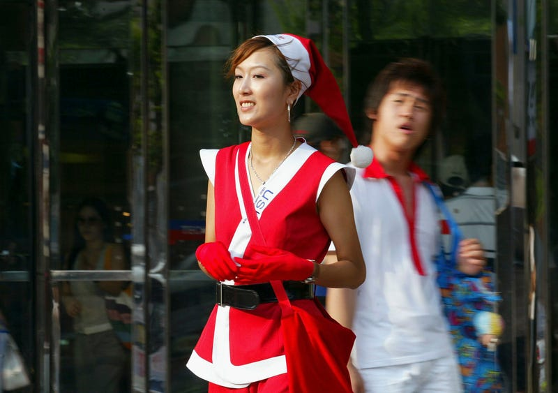 woman wearing summery santa suit