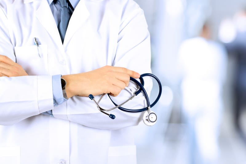 male doctor holding a stethoscope
