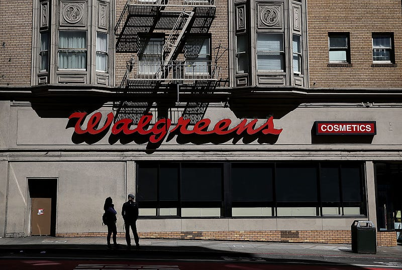 Pedestrians walk by a Walgreens store on April 5, 2016 in San Francisco, California.