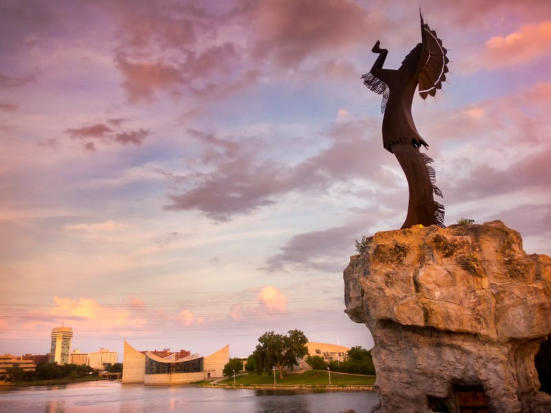 Beautiful sunset with the Keeper of the Plains in Wichita, Kansas