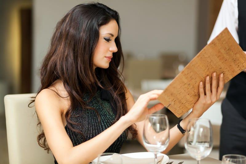 woman splurging on expensive dinner