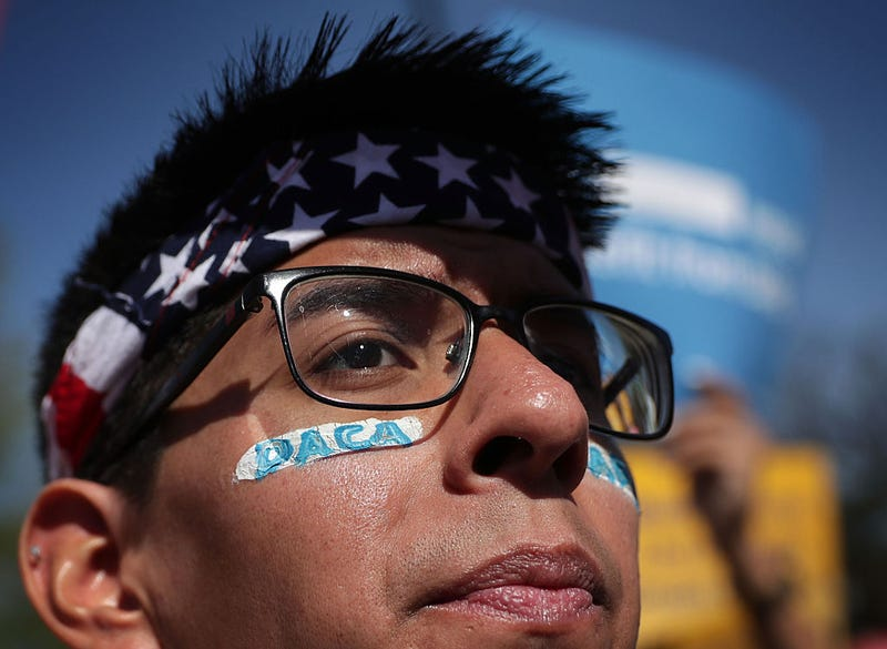 Pro-immigration activist Omar Martinez attends a rally in front of the U.S. Supreme Court