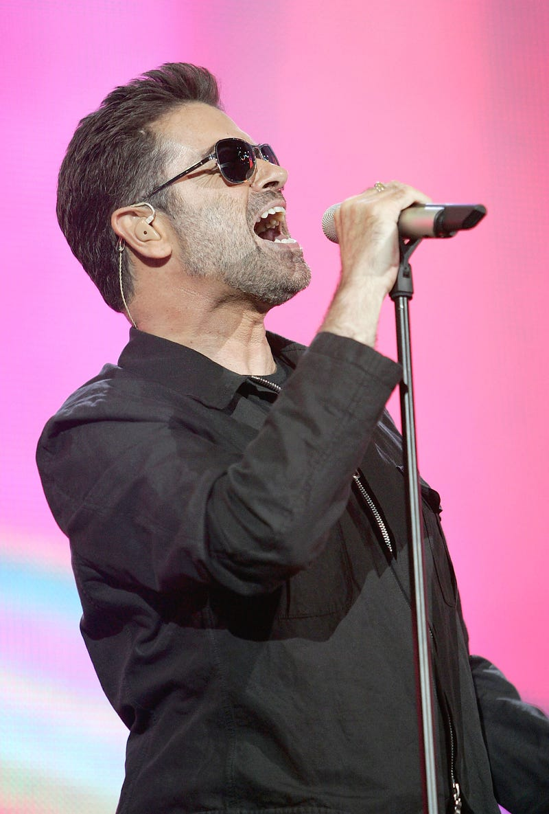 """Singer George Michael performs on stage at """"Live 8 London"""" in Hyde Park on July 2, 2005 in London, England. The free concert is one of ten simultaneous international gigs including Philadelphia, Berlin, Rome, Paris, Barrie, Tokyo, Cornwall, Moscow and Johannesburg. The concerts precede the G8 summit (July 6-8) to raising awareness for MAKEpovertyHISTORY."""