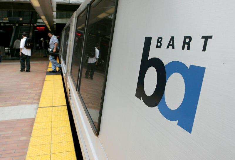 Commuters walk off of a Bay Area Rapid Transit (BART) train July 5, 2005 in San Francisco, California