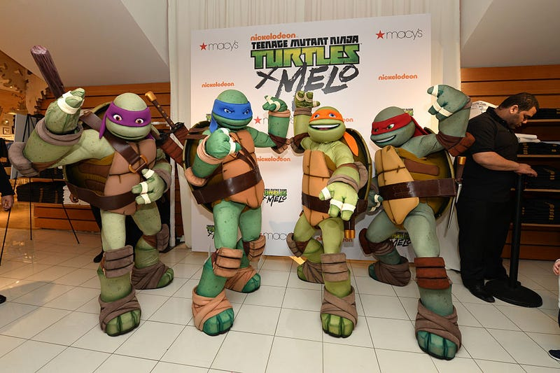 The Teenage Mutant Ninja Turtles pose at Macy's Herald Square for the Launch of TMNT X Melo on May 21, 2016 in New York City.