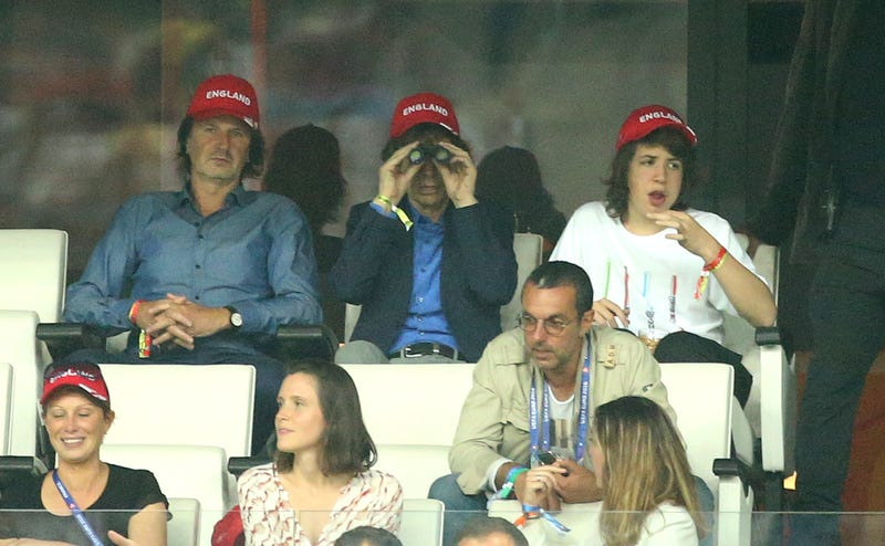 mick jagger uses binoculars at soccer game