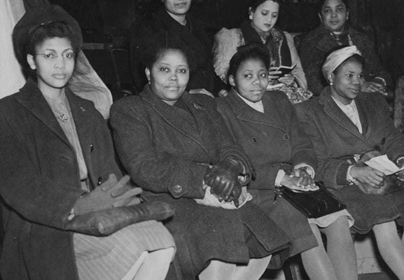 Delegates from all over the world at a meeting to celebrate International Women's Day; (L-R) Marie Campbell (Jamaica), Miss Hazeley (Sierra Leone), Miss Inyang (Nigeria) and Miss Ikpeme (Nigeria), London, March 8th 1947.