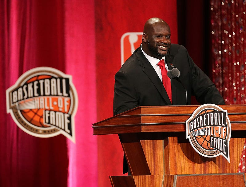 Shaquille O'Neal speaks at a Hall of Fame ceremony.