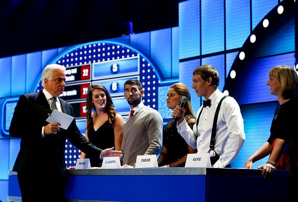 Actor John O'Hurley leads a game of Swimmer Family Feud.